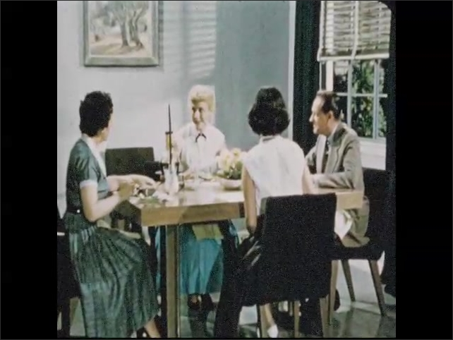 1950s: Man gets suitcases out of car, three women walk up path towards house. Man, woman, and two young women sit around dinner table, eat and talk.