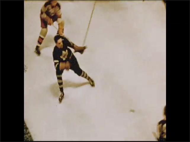 1950s: People ice skate on outdoor rink. Madison square Garden neon sign. Hockey players play hockey.