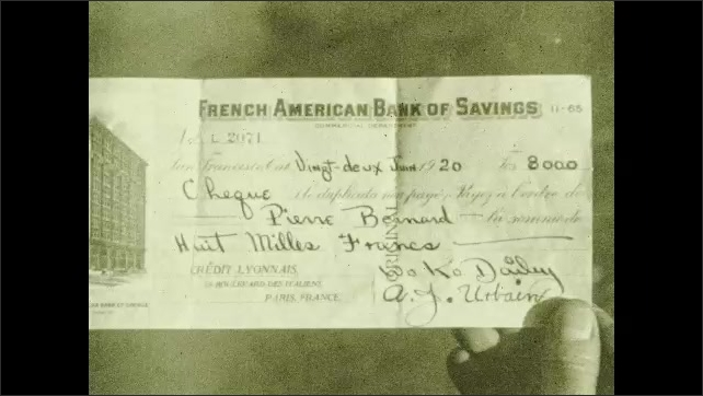 1920s: EUROPE: French American Bank of Savings cheque. Man reads letter and finds cheque. Man jumps for joy. Man shows letter to family. Twentieth Century Pilgrims.