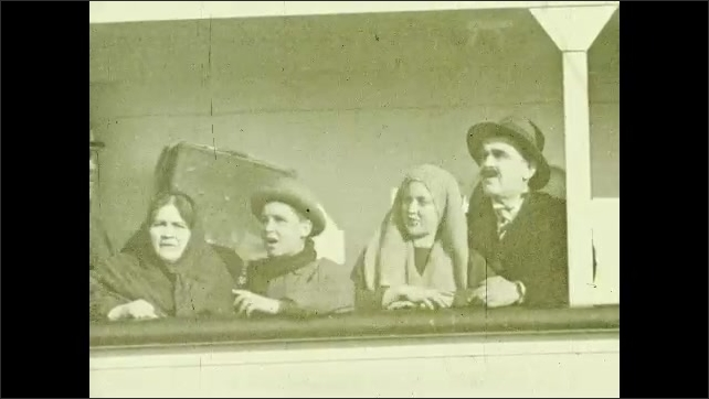 1920s: EUROPE: migrant family see New York from ship for first time. Port in New York.