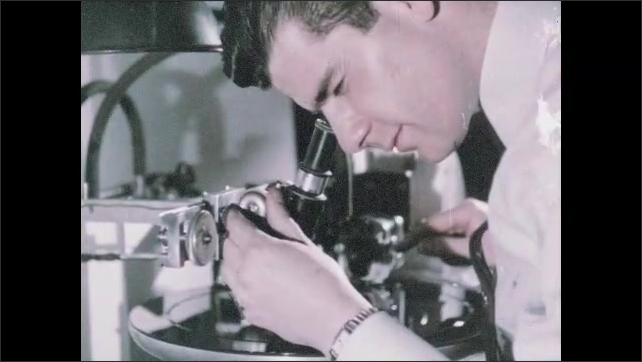 1950s: UNITED STATES: needle makes test groove on vinyl record. Lead in groove on master record