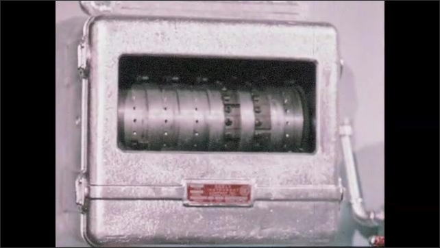 1950s: UNITED STATES: man makes metal copy from master record. Close up of silver plating machine. Man works with machines
