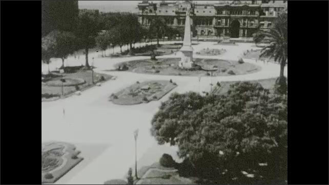 """1930s:??View from above of plaza and public space in Buenos Aires and the Mayan Pyramid monument.?? """"Monument of the Spanish"""" statue.????"""