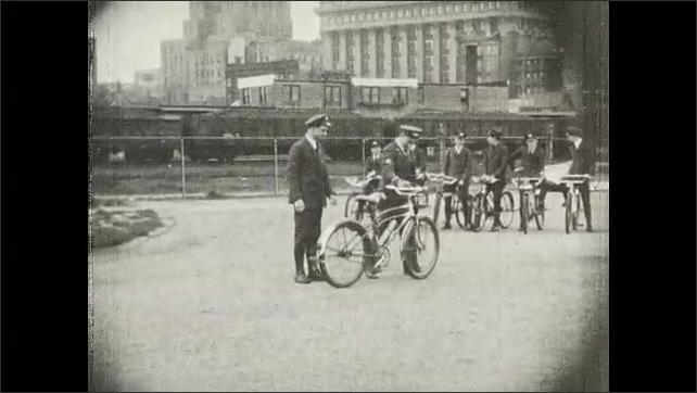 1930s: UNITED STATES: men walk outside shop. Men receive training in bike safety.