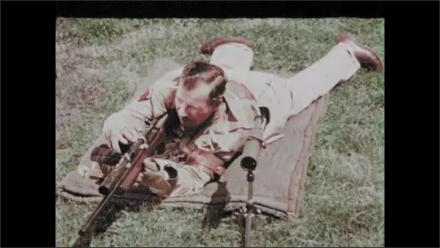 1950s: UNITED STATES: rabbit runs across field. Man shoots from ground. Man shoots target. Paper target with gun holes