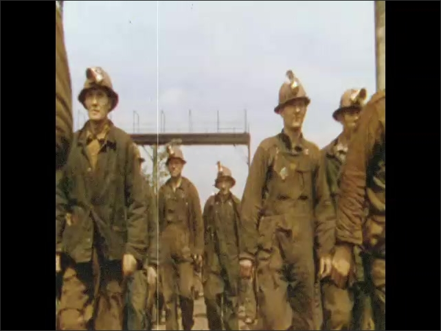 1950s: UNITED STATES: man polishes stainless steel surface. Miners walk together. People walk across bridge.