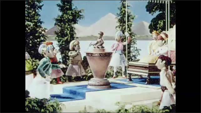 1950s: The water level in a jug dropping as it spins. Claymation men in turbans stand around a sculpture, speaking. The image zooms out to a framed picture in a modern room.