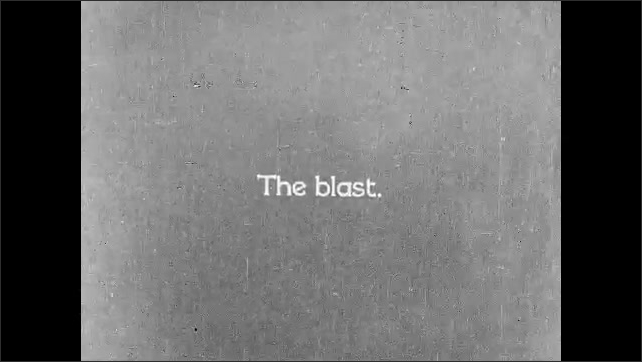 """1930s: Intertitle """"Drilling shot holes with air compressor drills"""".  Mine workers drill and fill holes. Intertitle """"the blast"""". Dynamite explosion."""