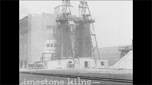 """1930s: Intertitle """"Insulating blocks are made from magnesia - taken from limestone - combined with asbestos fiber"""". Limestone kilns and plant."""