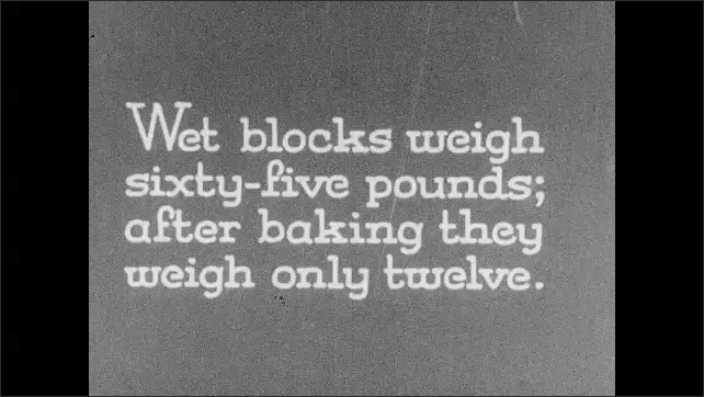 """1930s: Intertitle """"Wet blocks weigh 65 pounds; after baking they weigh only 12"""". Male workers load and unload ovens with asbestos panels."""