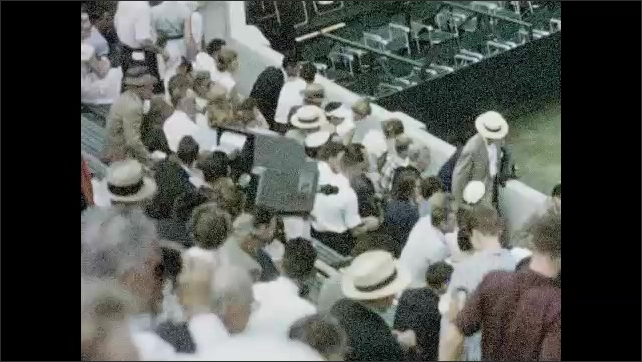 1950s: UNITED STATES: crowd watches baseball match. NBC television vehicles on location. Davis Cup tennis matches in 1955. Man plays tennis