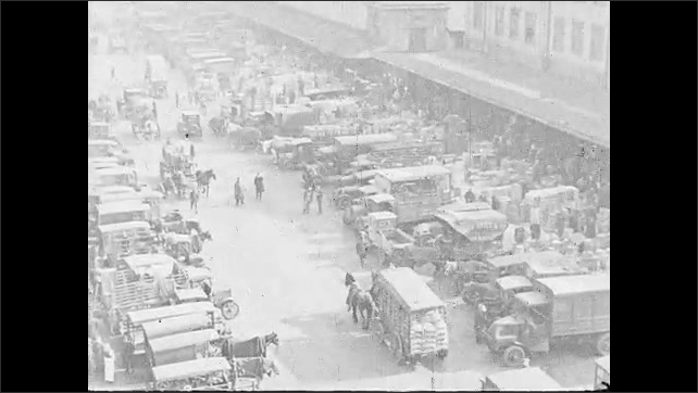 1930s: UNITED STATES: trucks at market. Horses pull cart t market. Man puts fish in scales. Men at fish market.