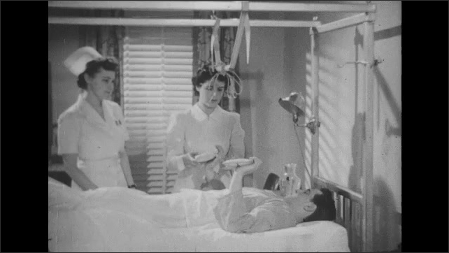 1950s: Nurse tends to man in hospital bed, ties string onto bar above bed, hands man small weights. Man lays on back, lifts weights up.