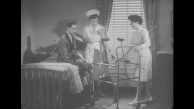1950s: Nurses help man use walker.