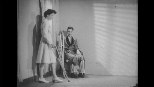1950s: Man moves across floor on crutches. Man sits in chair, watches nurse use crutches.