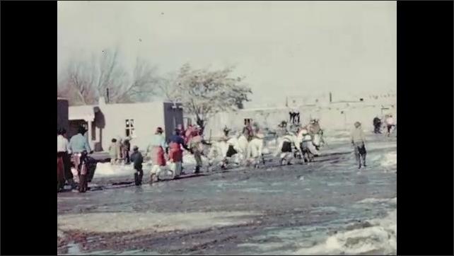 1930s: Village.  People walk past.  Native American ceremony.