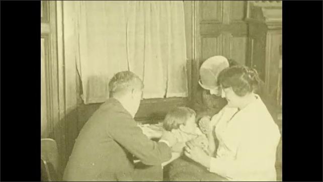1930s: UNITED STATES: children in school. Children see doctor at school. Doctor vaccinates child. Nurses speak to women in meeting