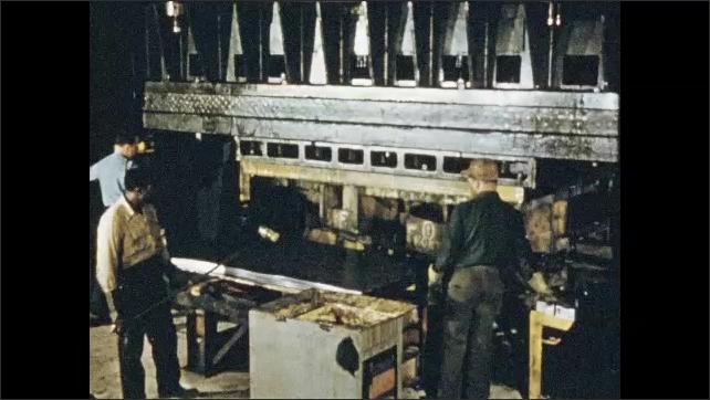 1950s: Metal pouring into molds. Men welding, tilt down to piece of metal. Men put sheet metal in press. Men take metal from press. Cut in sheet metal.