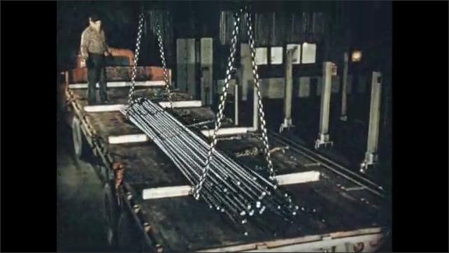 1950s: Hands measure metal rod. Chains drop bundle of metal.