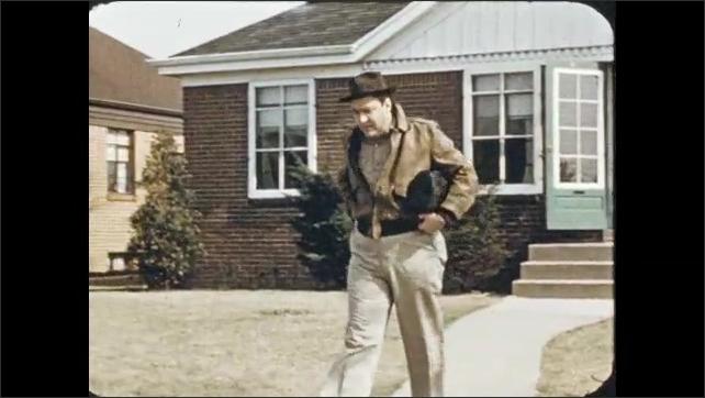 1950s: Man exits house, blows nose, talks to woman, walks down street. Train hauls metal ingots.