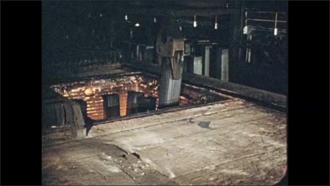 1950s: Fire burning in furnace. Men take metal part from press. Machine places metal ingot in vat. Hand chisels metal. Man welding. Sheet metal moving through machine.