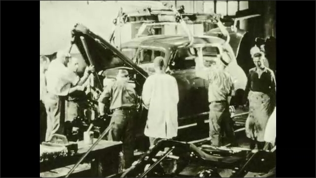 1940s: Train pulls up to platform, people board. Factory, heavy machinery parts move, men assemble Volkswagen beetle on assembly line. Road traffic. Passenger train. Ship.