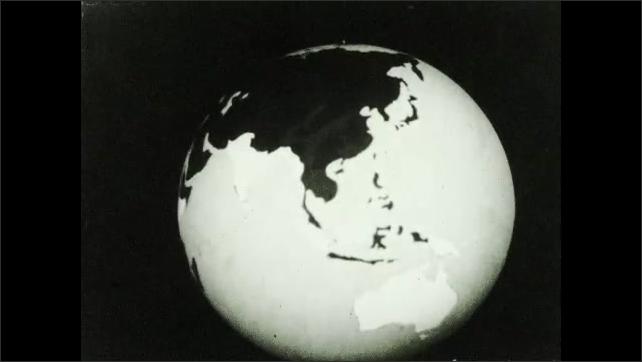1930s: UNITED STATES: spinning globe of world against black background. Ceylon on map.
