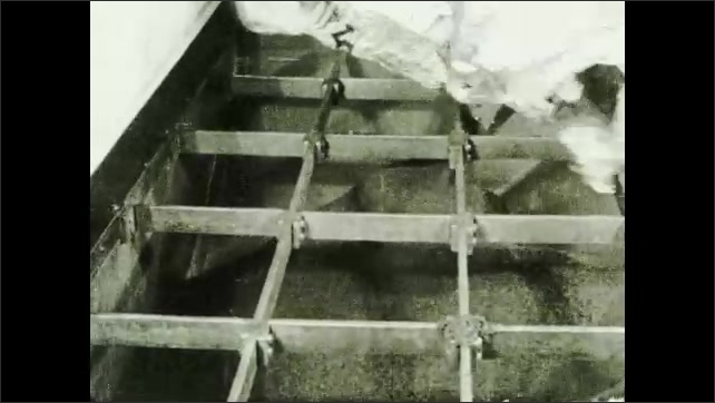 1930s: UNITED STATES: workers empty boxes of tea into container.