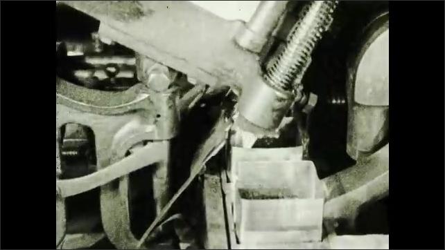 1930s: UNITED STATES: machine seals boxes of tea.