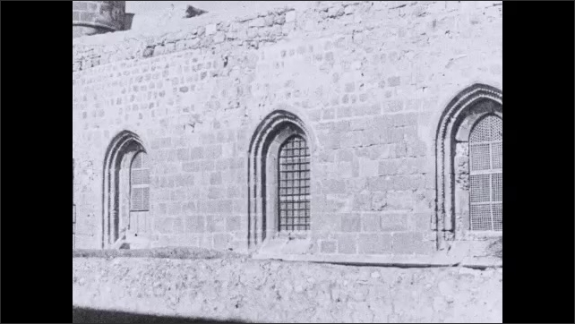 1930s: Windows on side of stone building.