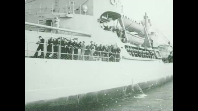 1930s: Men pull airplane onto deck.  Man salutes.  Crowd waves to departing aircraft carrier.  Men stand on deck.