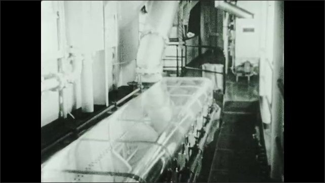 1930s: Radar dish spins around. Man stands at controls of tow boat at night. Radar screen.