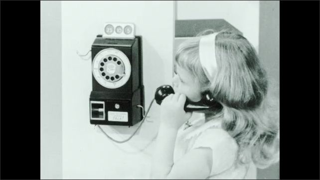 1960s: Hands put together car model. Hands dial play phone. Girl speaks into handset of phone. Hand replace receiver. Man with glasses speaks.