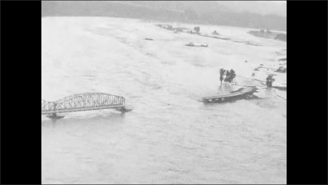 1960s: Flooded town, washed out bridge.