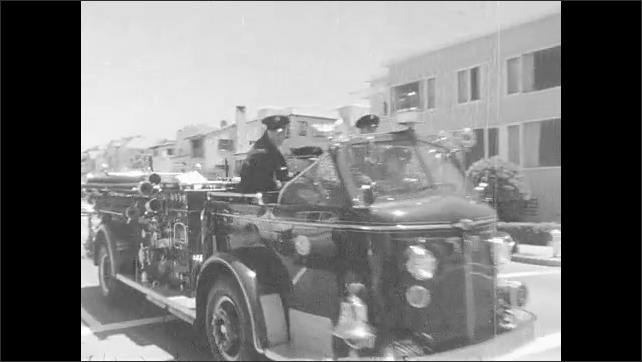 1960s: Woman sits topless on beach, men clap. Crowd gathers near beach. Police officers stand near crowd. Firetruck drives down the street. Woman leaves beach, crowd follows.