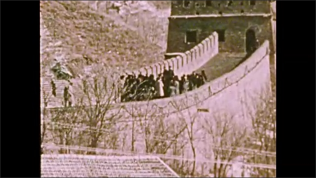 1970s: UNITED STATES: Great Wall of China. People congregate on Great Wall of China. Men shake hands. President visits China