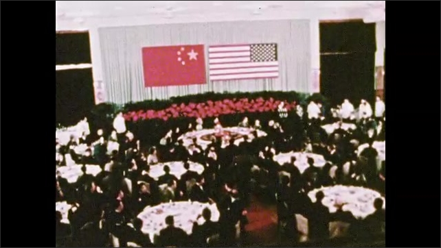 1970s: UNITED STATES: men talk in meeting. Men toast at conference. Ladies walk in street.