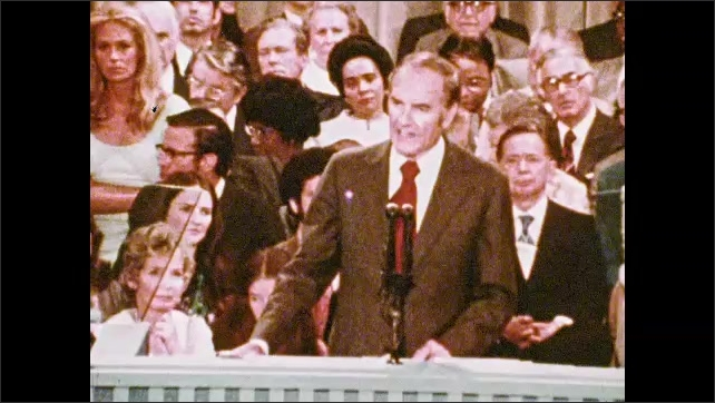 1970s: UNITED STATES: man speaks at National Convention in Miami Beach. Man speaks into microphone. People clap at convention.
