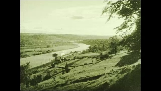 "1930s: Steam train passes next to river. Intertitle ""Mohawk Tributary"""