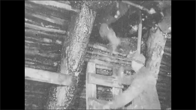 1930s: Machines wind string onto spools.  Man climbs ladder.  Men work in mine.