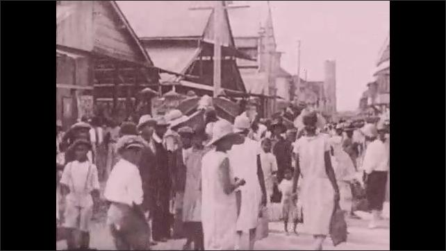 1930s: UNITED STATES: people in Port Au Prince, Haiti. Ladies in market. Ladies carry baskets. People in street. Voodooism in Haiti