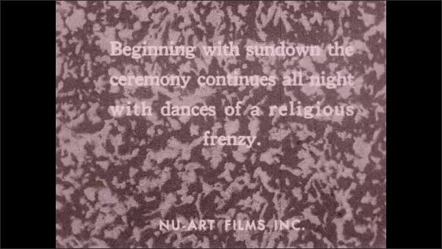 1930s: UNITED STATES: voodoo sundown ceremony in Haiti. Voodoo dance frenzy. Men play drums. Dog on dance floor