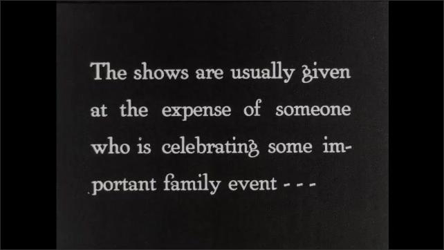 1930s: Man manipulates puppets. Intertitle card.
