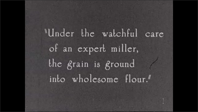 """1930s: Intertitle """"Then to the grinding mill"""" Grinding mills at the ready. Intertitle about millers grinding grain into flour. Miller peers into grinders."""