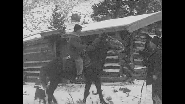 1930s: UNITED STATES: The State Game Warden's Quarters title. Man arrives at station on pony. Men shake hands.