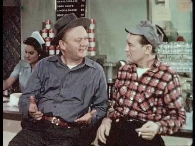 1950s: man in apron with broom talks. cigarette ashes and butts pile on the floor. man in hat sits on stool, talks and gestures to man in baseball cap in restaurant.