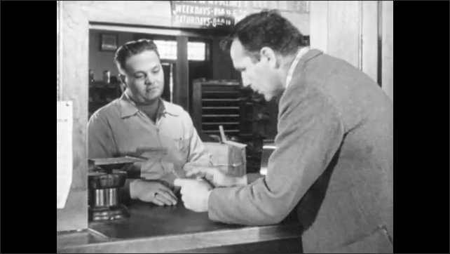1940s: Man hands man paper through window, men talk, man holds card. Two men sit at table, man writes check, tears it out of checkbook, hands it to other man.