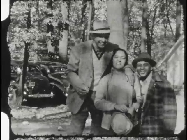 1940s: Man and women pose together outside, dance. Man joins couple. Pig and piglets in pasture.