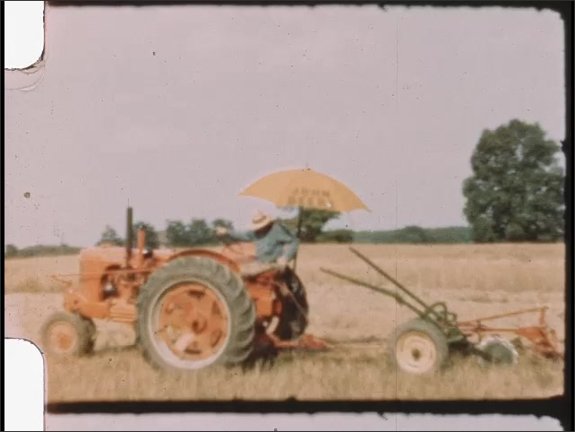 1940s: Woman reads newspaper in chair under tree. Man drives tractor over farm fields.