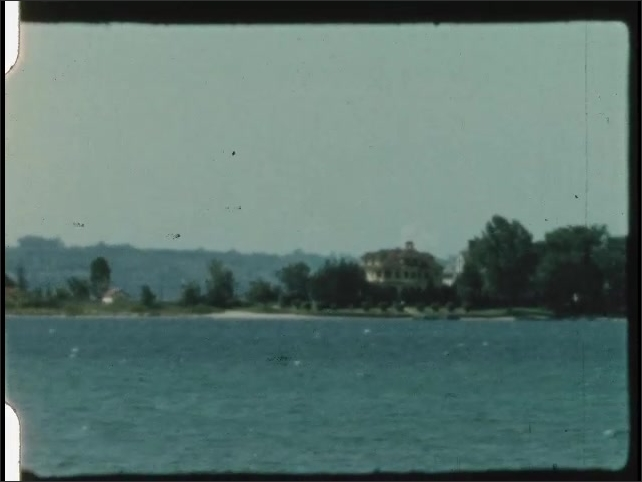 1940s: UNITED STATES: view across water to land. Waterfront homes.